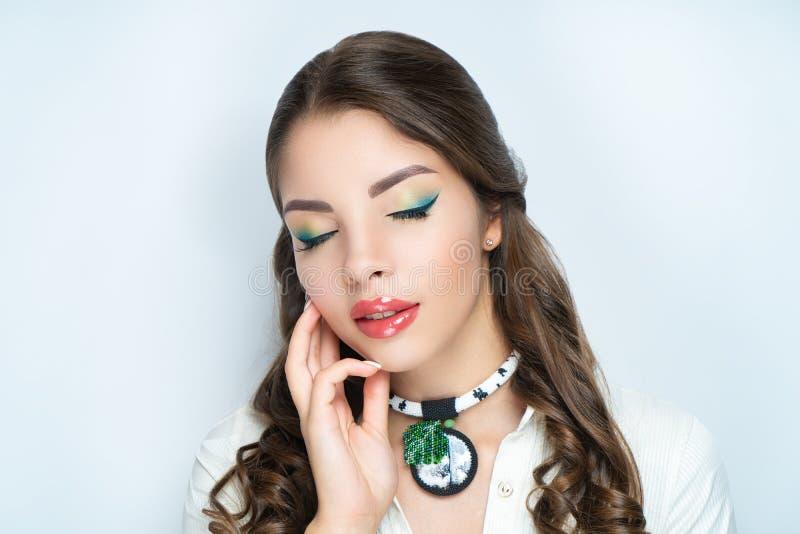 Le vert de visage de beauté de femme composent photo libre de droits