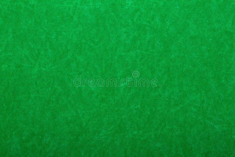 Le vert a ressenti sur la table de casino photos libres de droits
