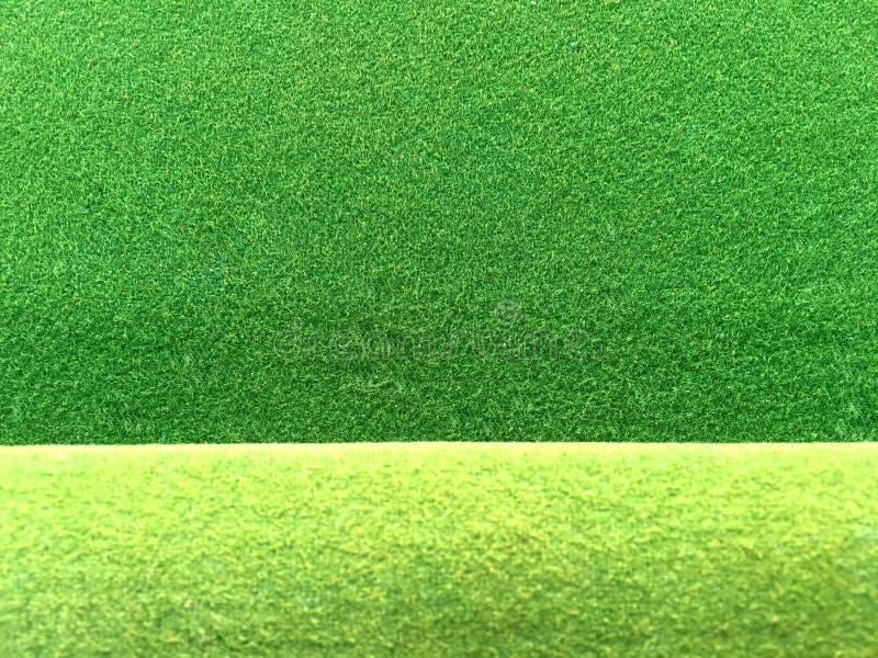 Le vert a senti la texture de tissu avec le fond vert clair de bord photos libres de droits