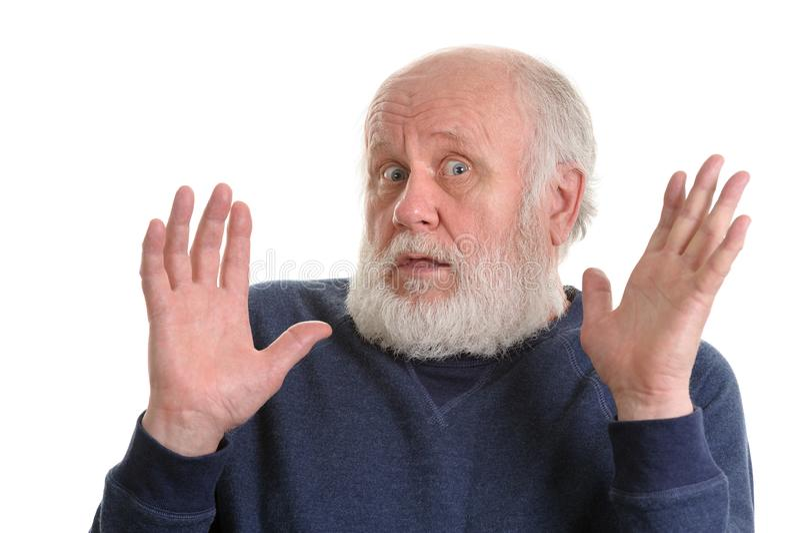 Le vieil homme montre ses paumes vides d'isolement sur le blanc photographie stock libre de droits