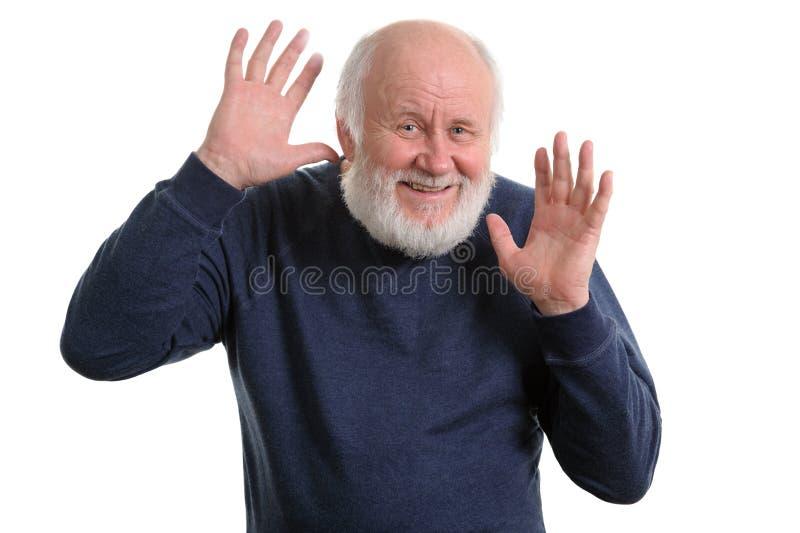 Le vieil homme montre ses paumes vides d'isolement sur le blanc image stock