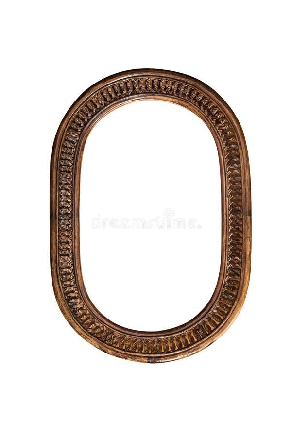 Le vieux brun ovale de miroir de frontière en bois de cadre sur le fond blanc choisissent un style unique antique décoratif tradi photographie stock libre de droits