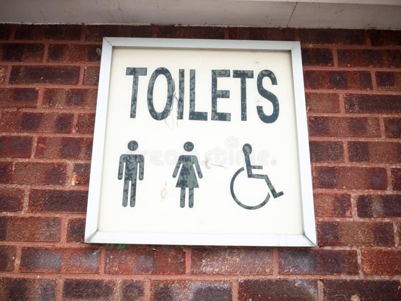 Le vieux rétro lettrage se connectent le mâle de toilettes de mur et la femelle et le DIS photo libre de droits