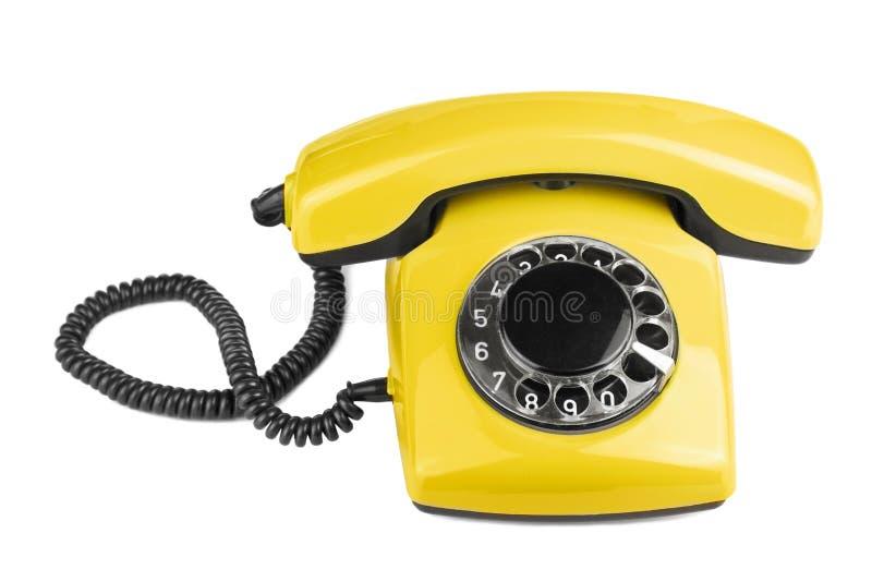 Le vieux téléphone jaune a isolé photo libre de droits