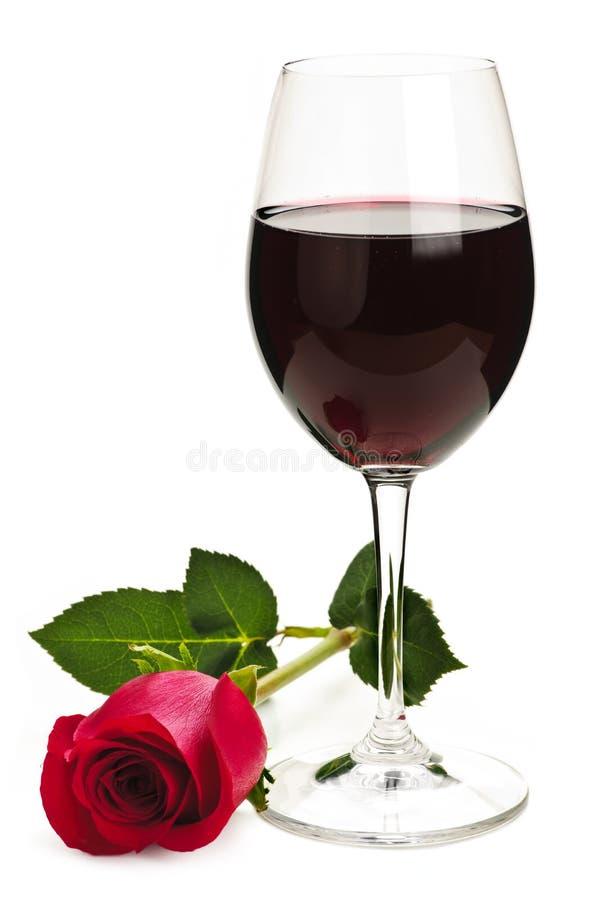 Le vin avec le rouge s'est levé photo stock