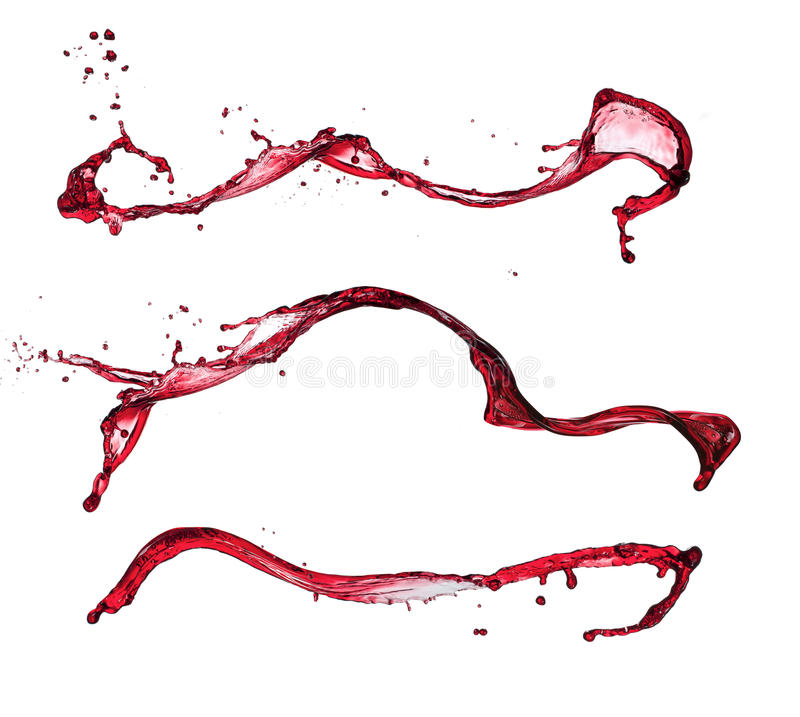 Le vin rouge éclabousse photographie stock libre de droits