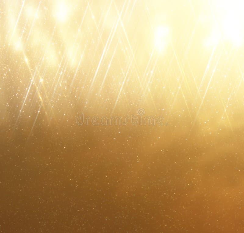 Le vintage de scintillement allume le fond Fond abstrait d'or defocused image libre de droits