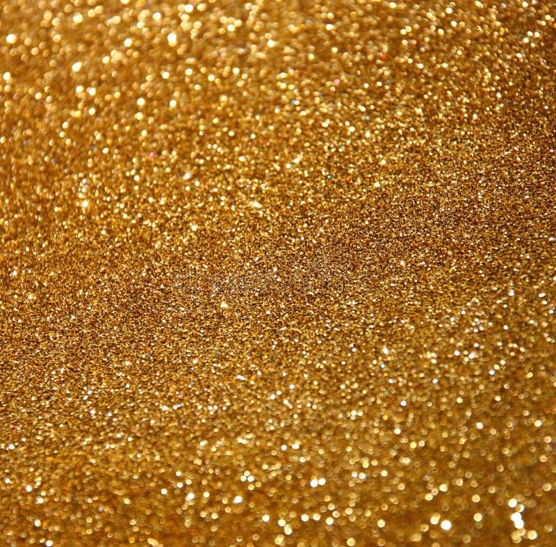 Le vintage de scintillement allume le fond Fond abstrait d'or defocused image stock