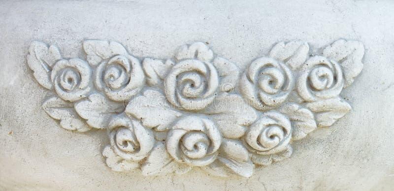 Le vintage fleurit le découpage en pierre images stock