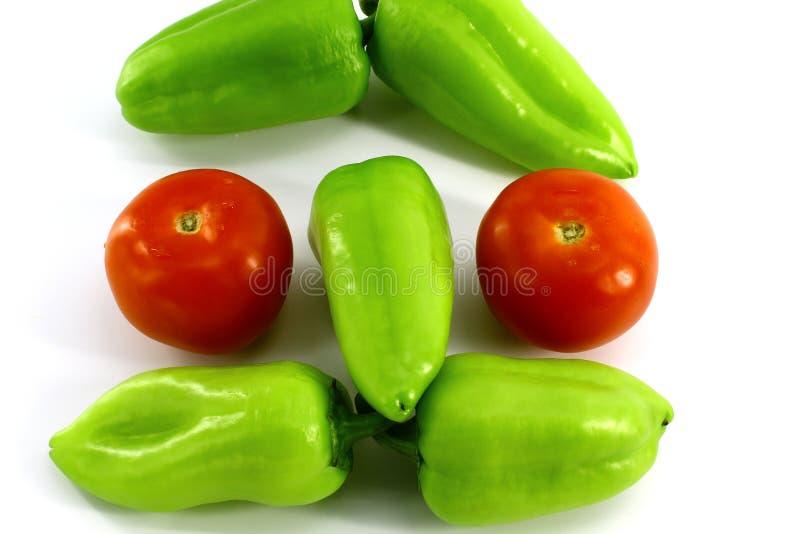 Le visage, a composé de légumes frais sur le fond blanc photos stock