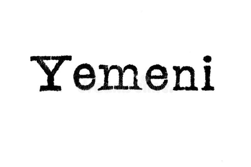 Le ` yéménite de ` de mot d'une machine à écrire sur le blanc image stock