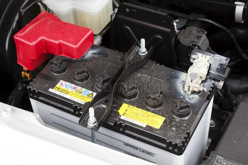 Lead acid car battery. Buckingham, UK - May 16, 2019. Car battery is fitted in a car engine compartment of a Suzuki Jimny. The lead acid car battery is designed stock images