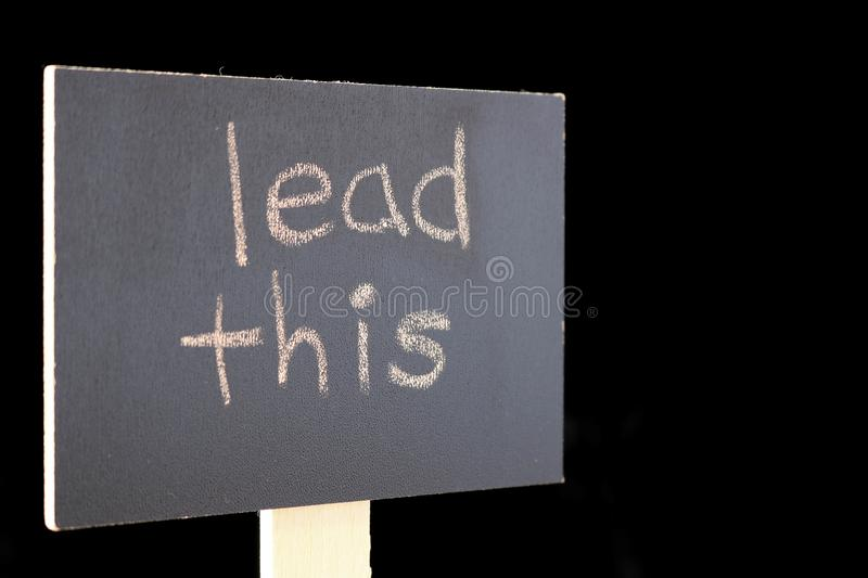 Lead this - chalkboard sign. Chalkboard or blackboard sign with `lead this` text - good for social media posts, blogs, internet publishing royalty free stock image