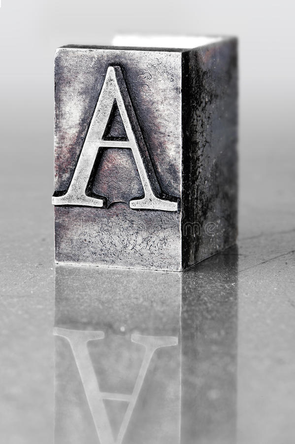 Lead letter A. The old printed matter was essential accessory of the wood, then metal (lead) made from letters, the use of which has replaced more than 500 years royalty free stock images