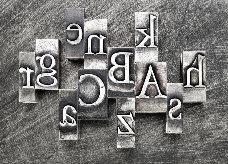 Lead letters. The old printed matter was essential accessory of the wood, then metal (lead) made from letters, the use of which has replaced more than half a royalty free stock photo