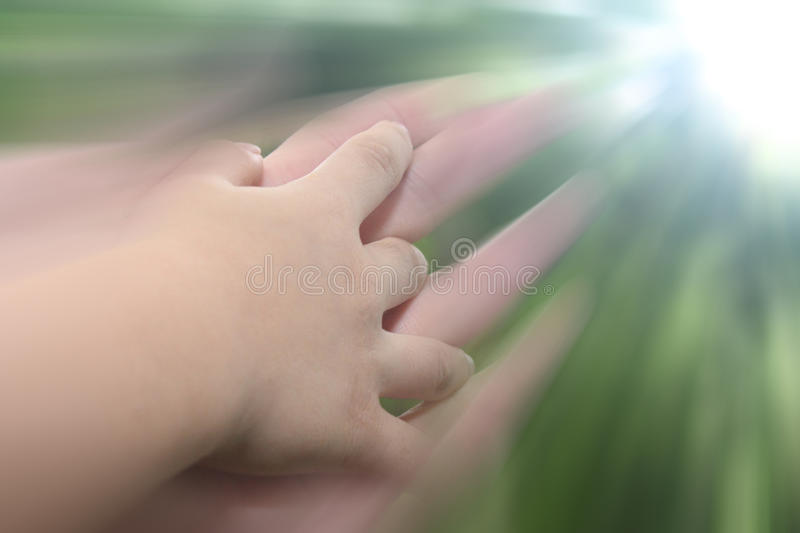 Lead Me to the LIGHT. A Child's hand holding on the father's in motion as he guides her in her internal spiritual journey of growth towards the LIGHT