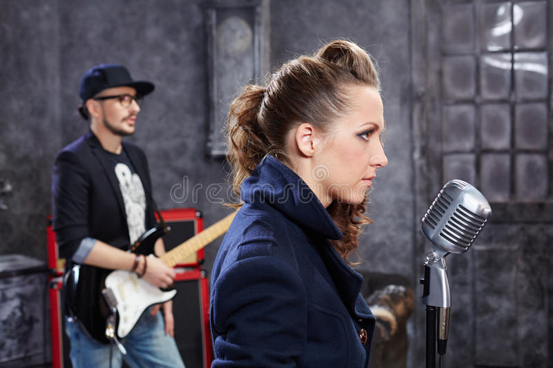 Lead singer stands at microphone royalty free stock images
