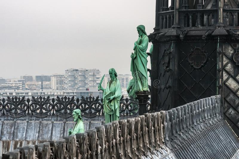 Lead statues around the spire of Notre Dame de Paris cathedral stock images
