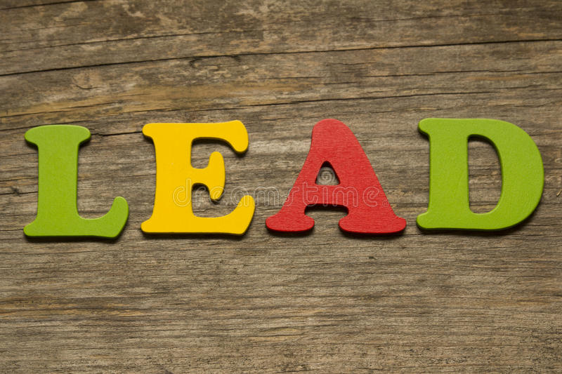 LEAD. Word lead on a wooden background stock image