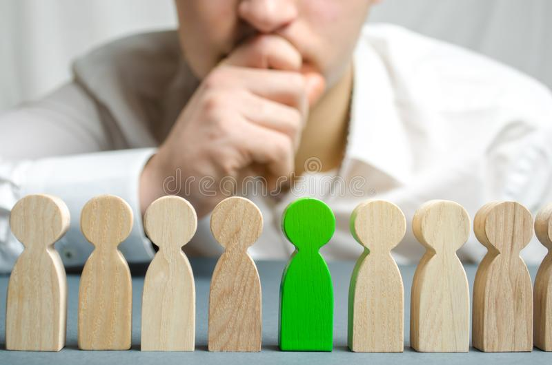 The leader chooses the person in the the team. Talented worker. Hiring staff. Employee search. Promote. Human Resource Management. Choosing a new leader in the stock photos