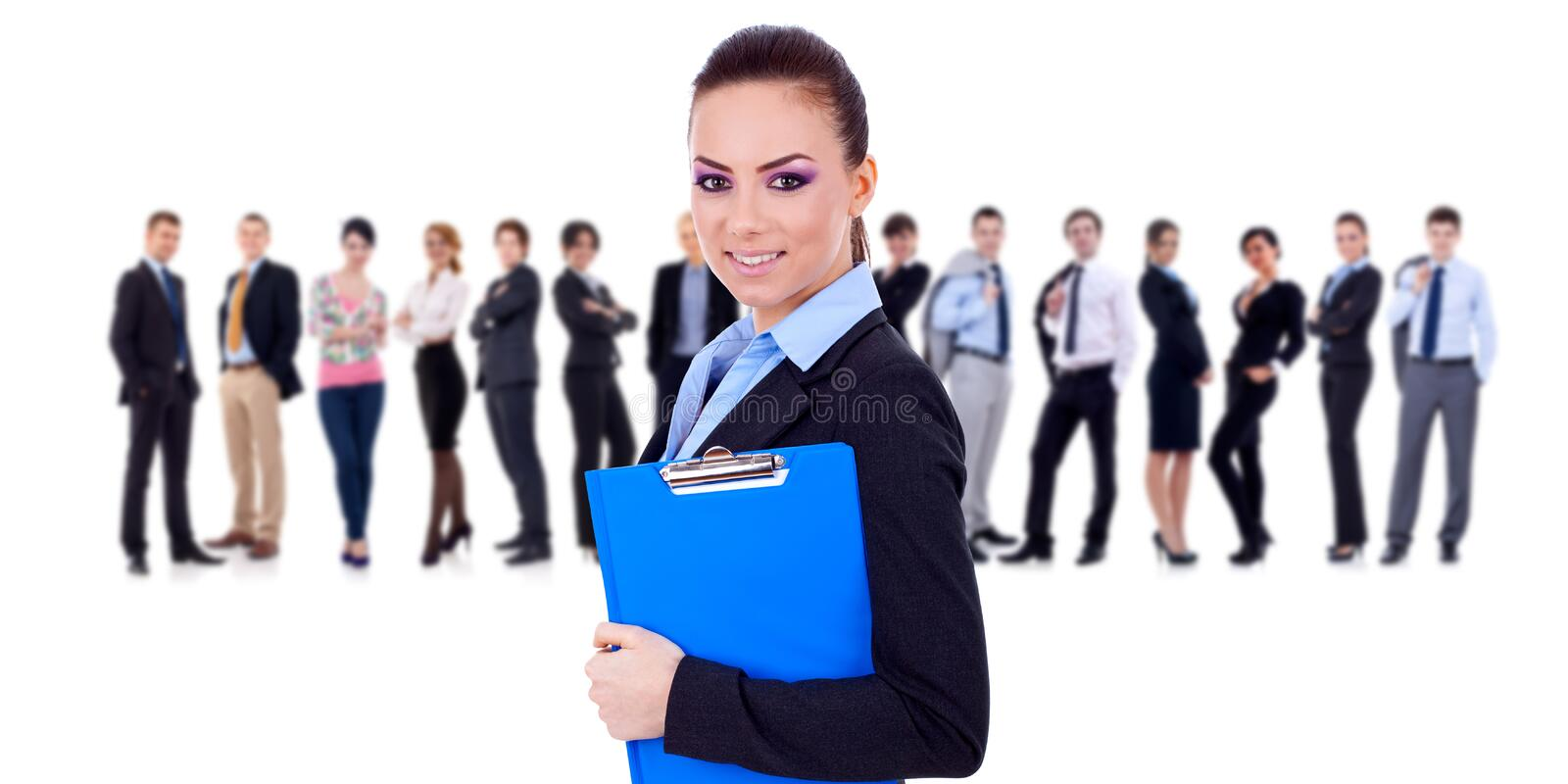Leader holding a clipboard, business team behind stock image