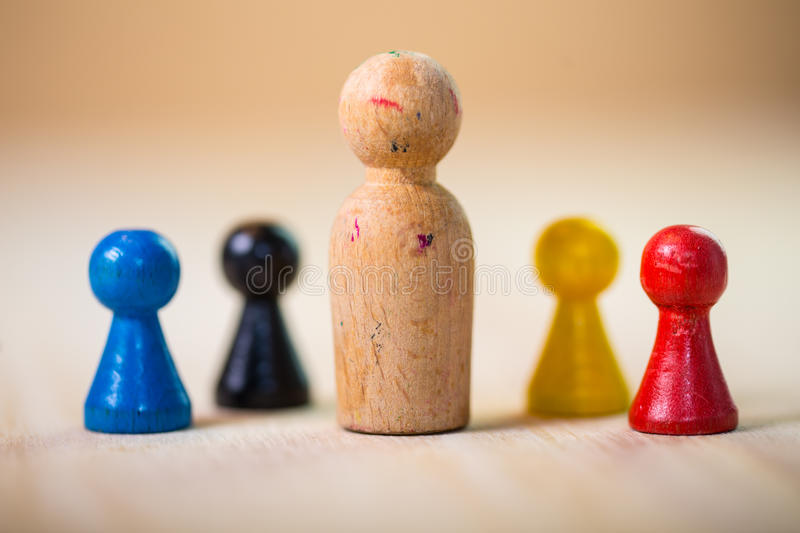 Leader. Leading a small team of wooden figures stock photos
