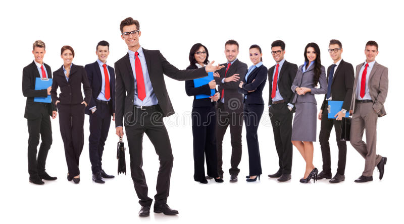 Leader presenting his successful business team stock photo