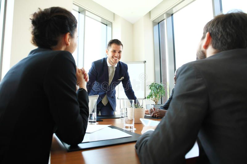 Leader showing business plan to colleagues during a meeting. royalty free stock images