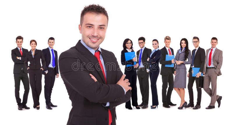 Leader standing in front of his successful business team. Young leader standing in front of his successful business team on white background royalty free stock photography