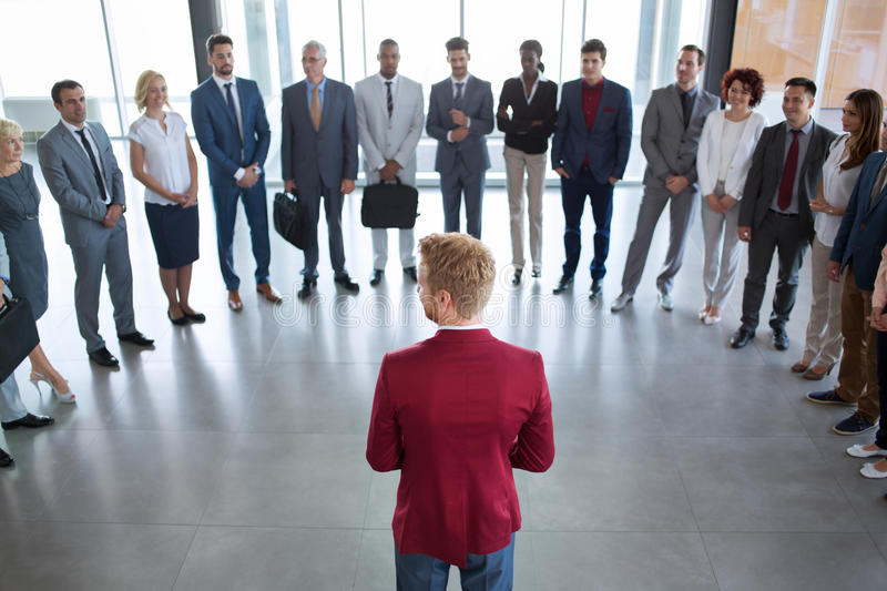 Leader standing in front of his successful business team stock images