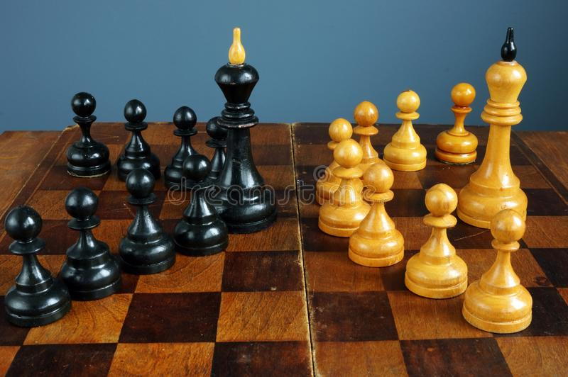 Leader vs boss or manager. Chess kings and pawns on desk. Leader vs boss or manager concept. Chess kings and pawns on desk royalty free stock photo
