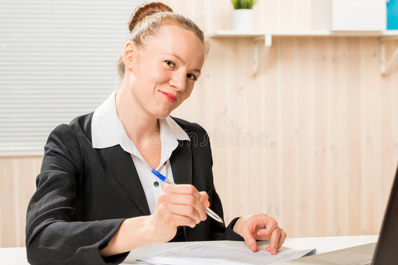 Leader woman posing signature on documents. Leader woman posing signature on important documents royalty free stock photography