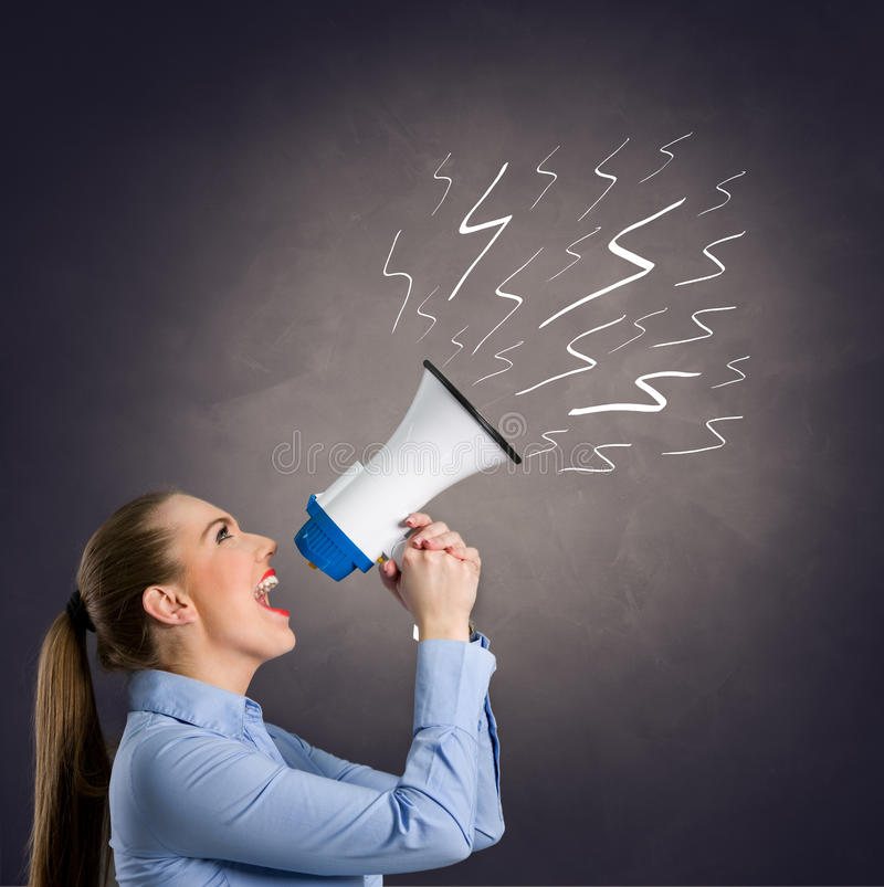 Leader woman shouting into megaphone. With hand drawn lightning on grungy background stock image