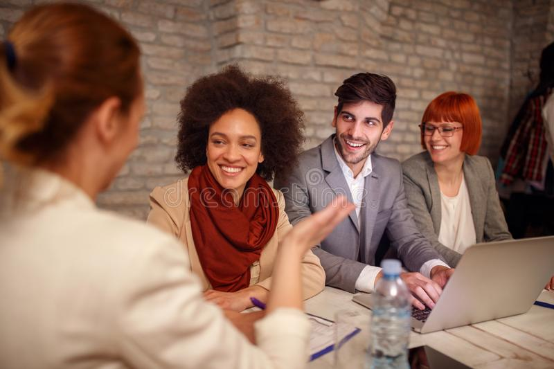 Leader women with employer discuss. On meeting stock photography