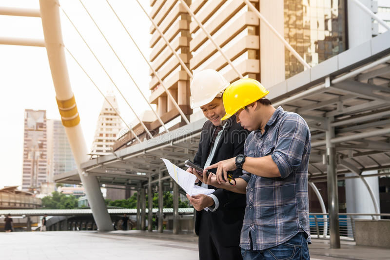 Leader and worker are work together stock photography
