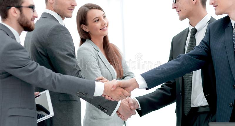 Leaders of business teams shake hands royalty free stock images