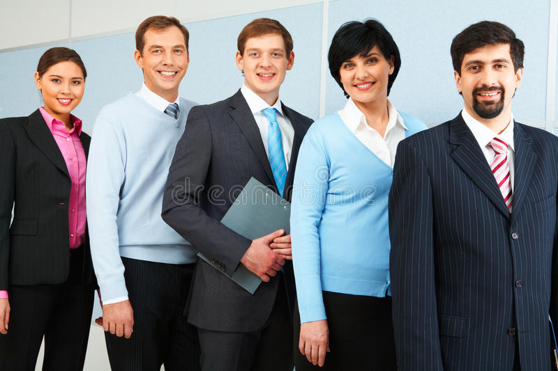 Leadership. Photo of successful employees looking at camera royalty free stock image