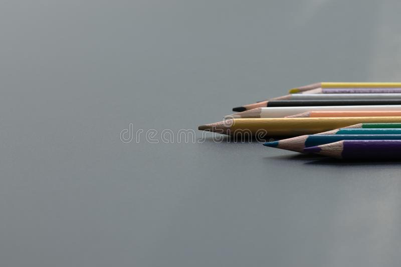 Leadership business concept. Gold color pencil lead other color on black background stock images