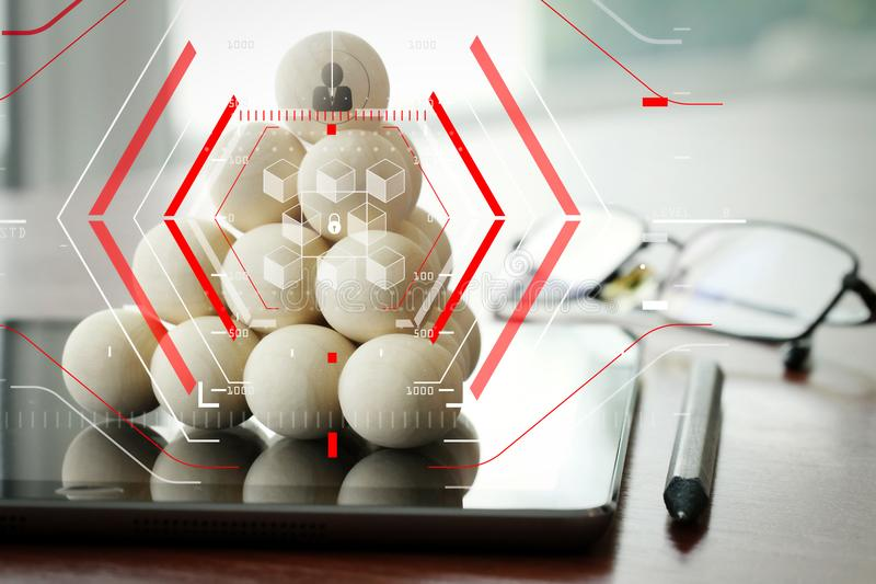 Leadership business concept,people icons on wooden balls on digital tablet computer. Blockchain technology concept with a chain of encrypted blocks.businessman royalty free stock image
