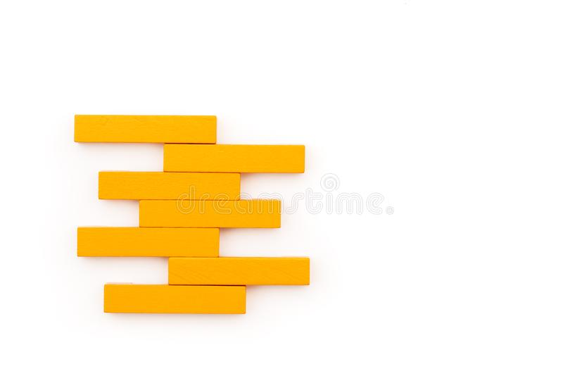 Leadership business concept. yellow wooden block stacking on white background stock photography