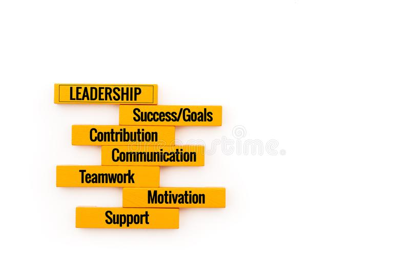 Leadership business concept. yellow wooden block stacking on white background stock image