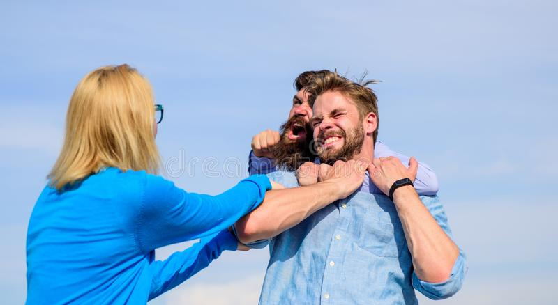 Leadership and competition concept. Love as fight and competition. Man aggressive attacks lover his girlfriend. Men stock photography