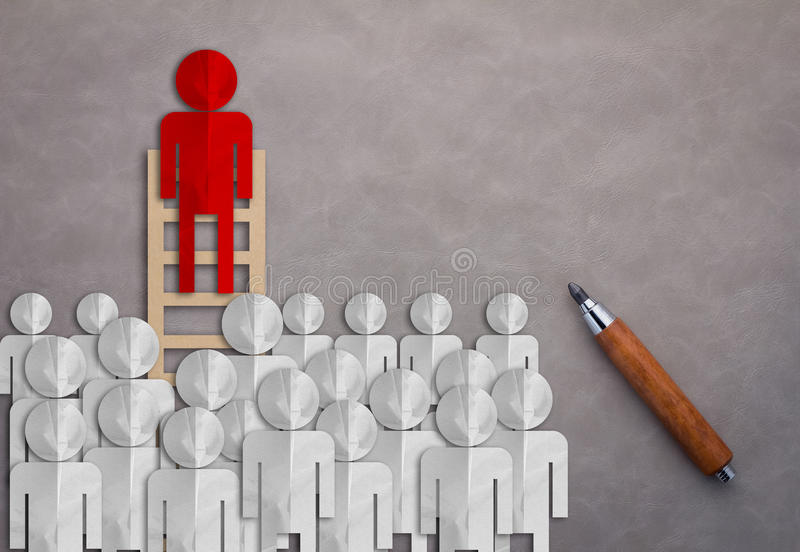 LEADERSHIP CONCEPT WITH BUSINESS MAN PAPER CUT ON LADDER royalty free stock image