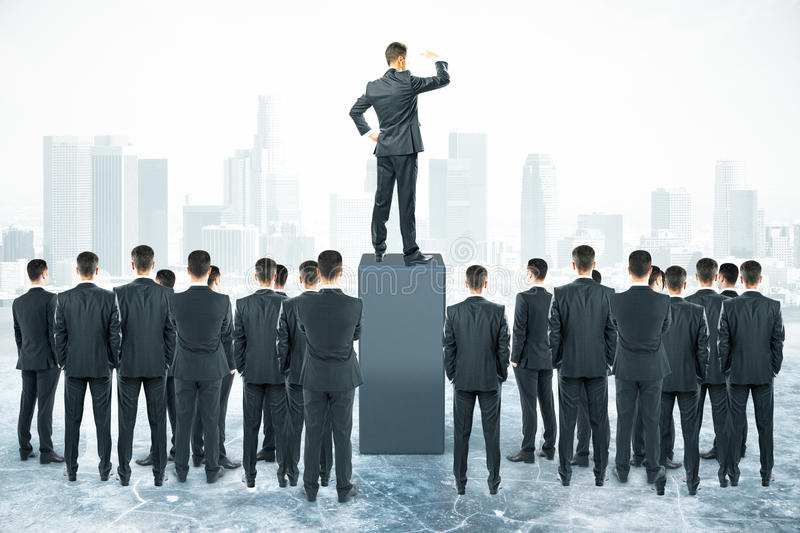 Leadership concept. With businessman standing on pedestal and looking into the distance with other businesspeople around royalty free stock image