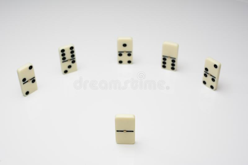 Leadership concept with domino tiles in circle royalty free stock photo