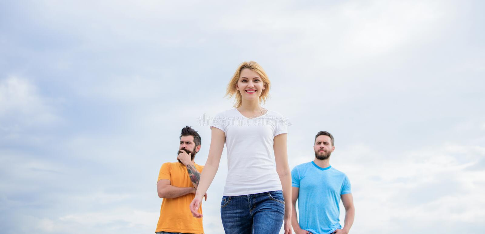 Leadership concept. Woman in front of men feel confident. Moving forward support male team. What makes successful female royalty free stock photography