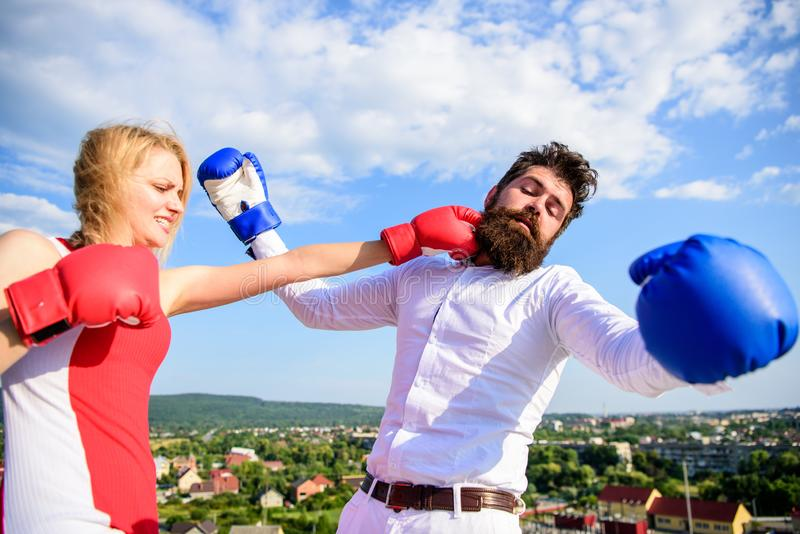 Leadership family relations. Couple boxing gloves fight sky background. Things guy can do to make woman happy. How to. Leadership family relations. Couple boxing stock photo