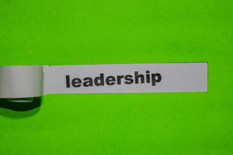 Leadership, inspiration concept on green torn paper royalty free stock image
