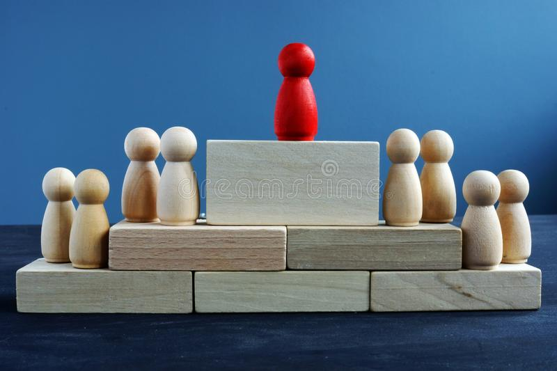 Leadership and management. Wooden figures and blocks stock photos
