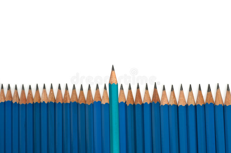 Leadership pencil. Decorative leadership turquoise pencil with isolated background royalty free stock photos